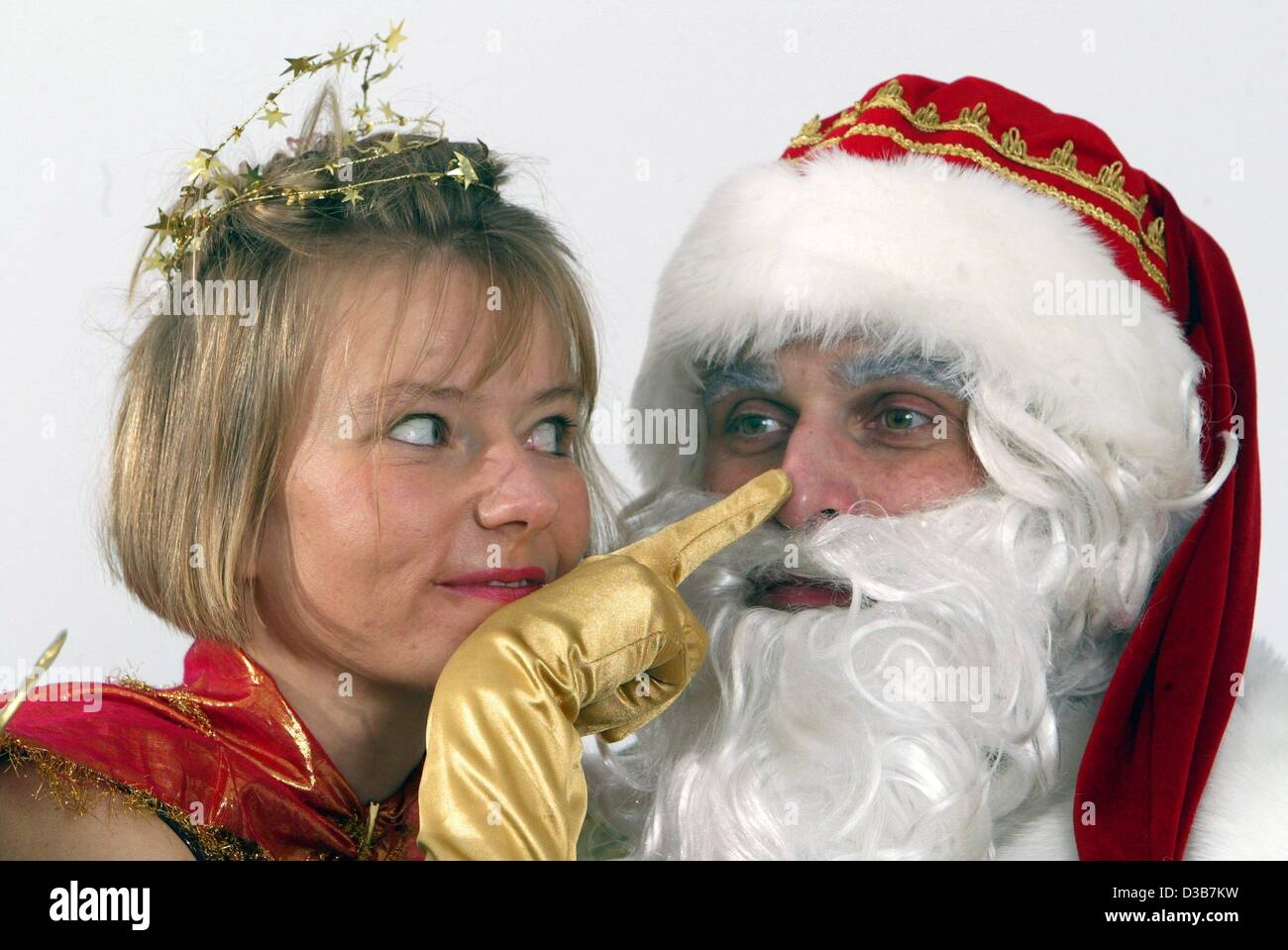 (dpa) - An angel touches Santa Claus' nose, Berlin, 17 December 2002. Behind their dresses are Joerg and Mendi - Stock Image