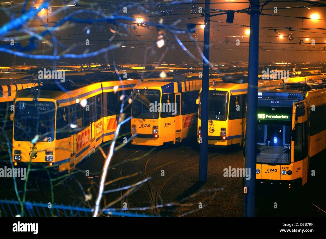 (dpa) - In the light of street lamps and spotlights streetcars stand in the depot in Essen, Germany, 17 December - Stock Image