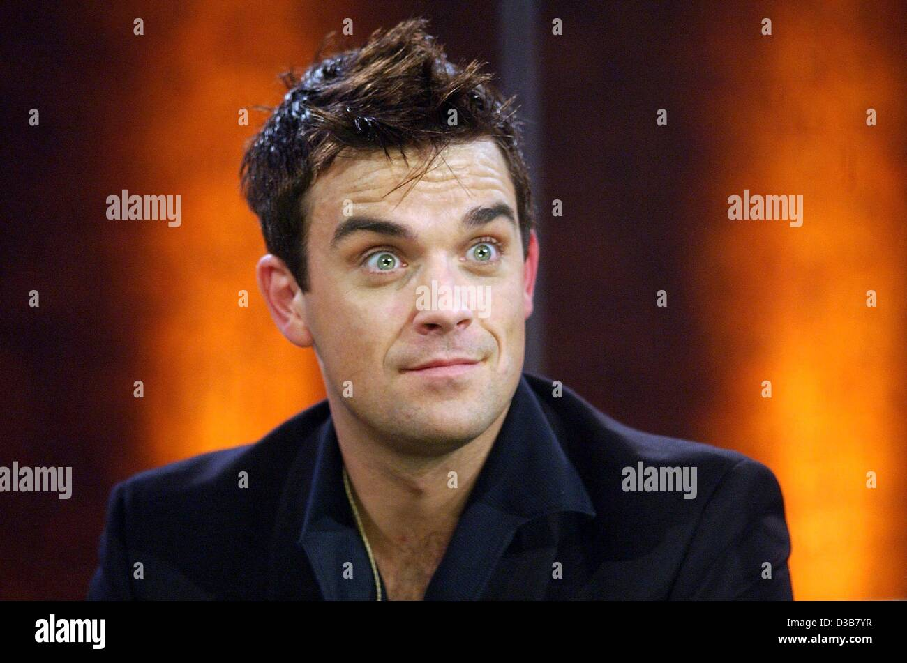 (dpa) - Surprised and with eyes wide open British pop star Robbie Williams looks on during the live TV show 'Wetten - Stock Image
