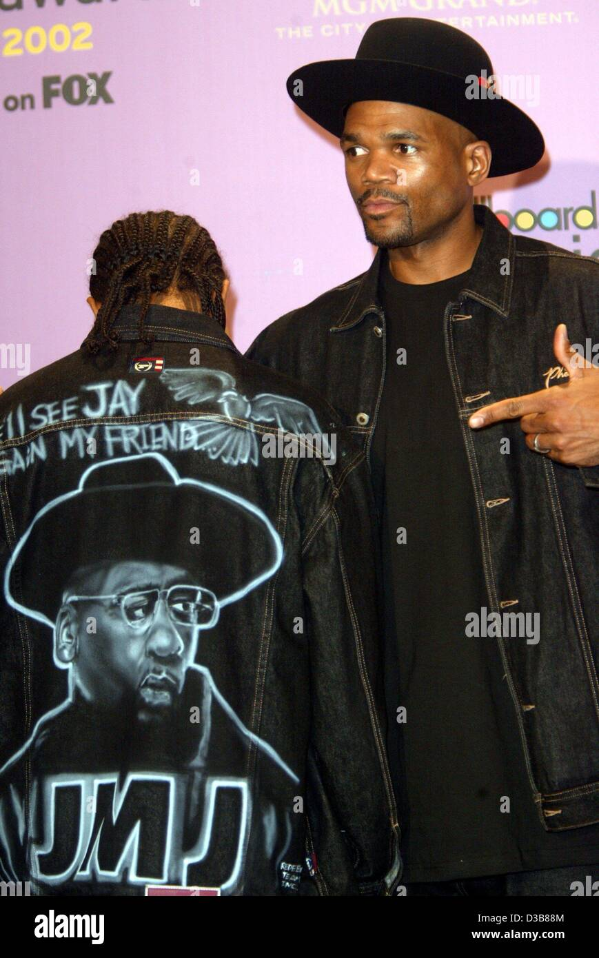 A member of the rap group 'Run - DMC'points to graffiti on the jacket of another band member, which shows - Stock Image