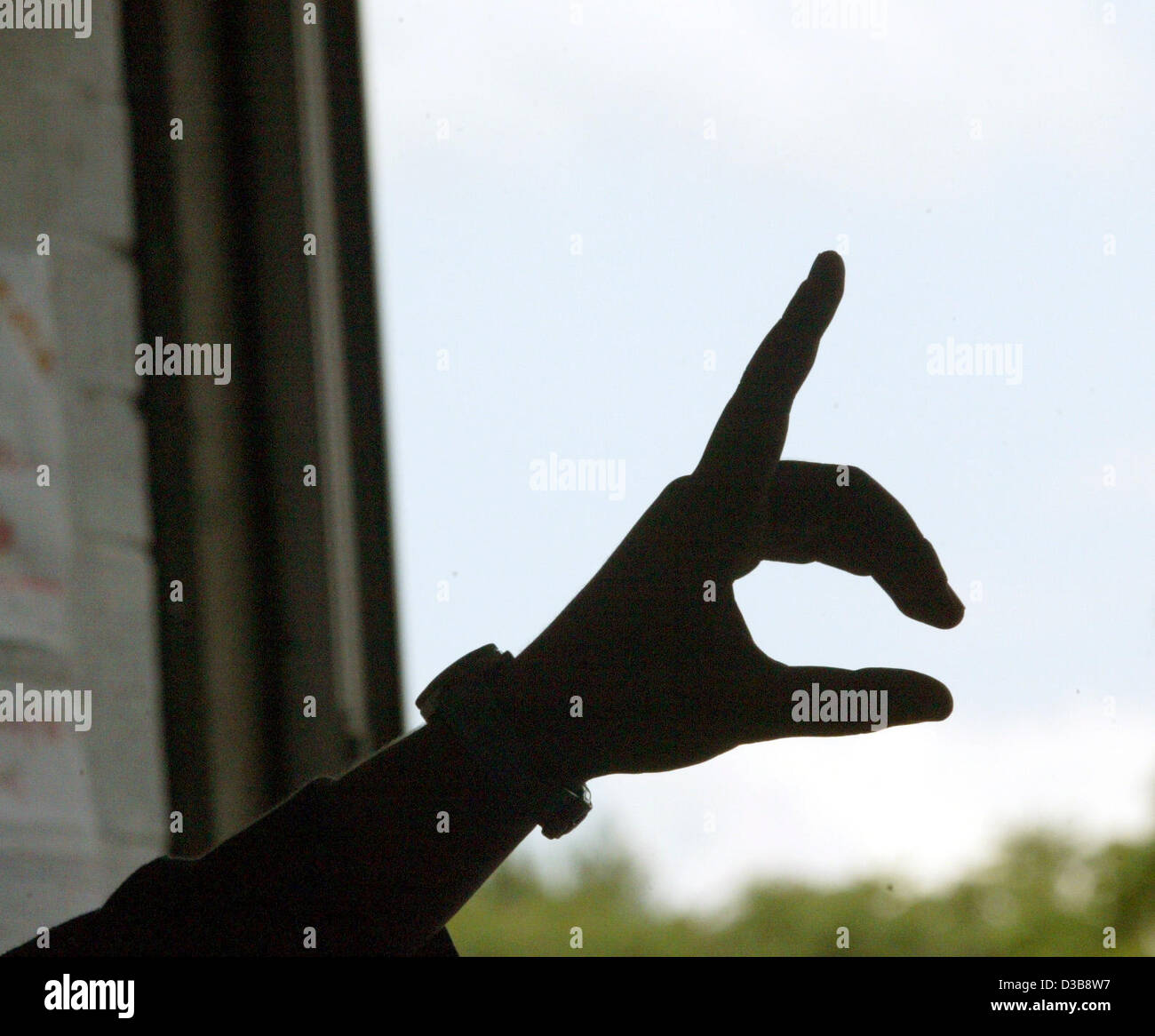 (dpa) - A student's finger is in the air to indicate the request to speak at the Stauding Full-time Comprehensive - Stock Image
