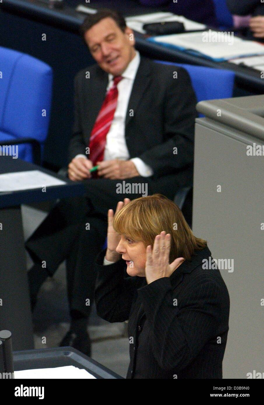 (dpa) - CDU chairwoman Angela Merkel gestures as she speaks in the Bundestag (lower house of German parliament), watched by Chancellor Schroeder, Berlin, 4 December 2002. Merkel said Schroeder was not fit for the neccessary tasks. Stock Photo