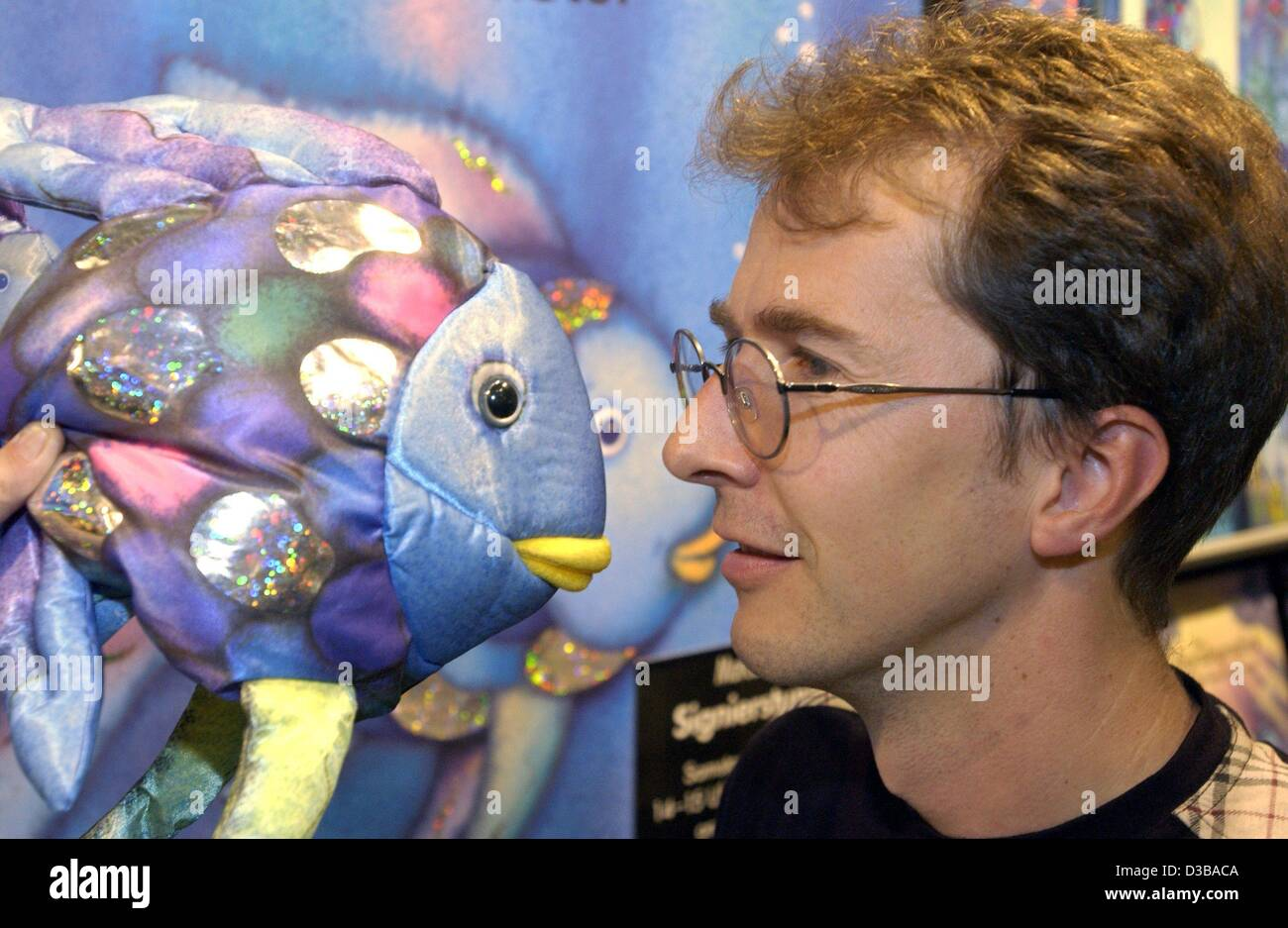 (dpa) - Swiss picture book author Marcus Pfister presents his 'Rainbow Fish' books at the Book Fair in Frankfurt, - Stock Image