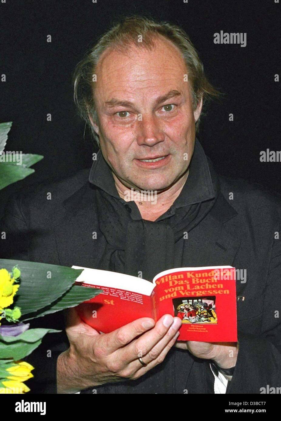 (dpa files) - Austrian actor Klaus Maria Brandauer flips through a book during a theater festival in Hanover-Herrnhausen, Stock Photo