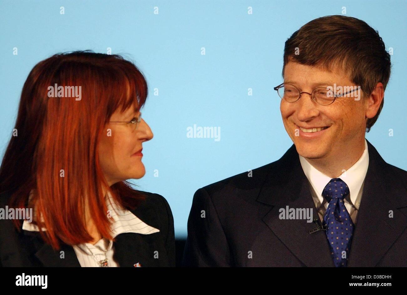 dpa) - Microsoft founder Bill Gates stands next to German