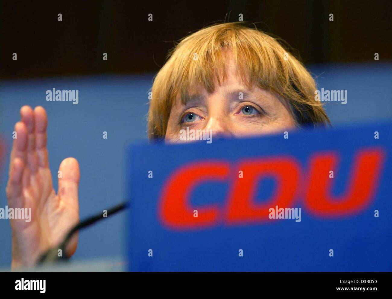 (dpa) - Angela Merkel, Chairwoman of the CDU party, gives a speech in the election campaign for the upcoming regional elections in the German state Lower Saxony, Osnabrueck, Germany, 23 January 2003. Merkel accuses Chancellor Schroeder of not taking the work of weapon inspectors of the United Nation Stock Photo