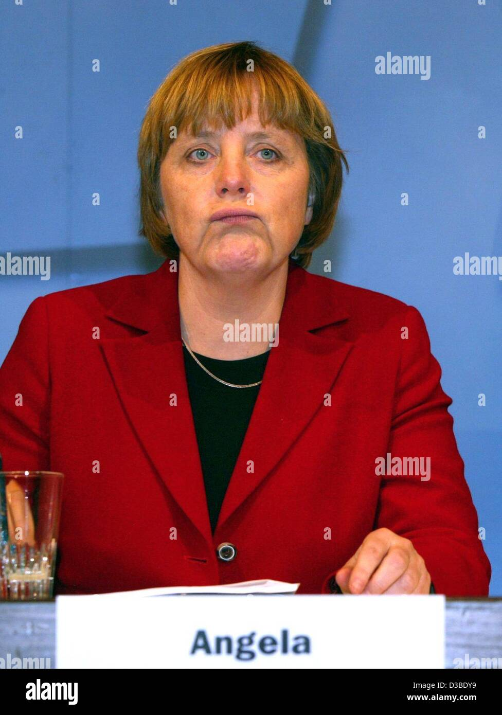 (dpa) - Angela Merkel, Chairwoman of the CDU party, stands behind a lectern in the election campaign for the upcoming regional elections in the German state Lower Saxony, Osnabrueck, Germany, 23 January 2003. Merkel accuses Chancellor Schroeder of not taking the work of weapon inspectors of the Unit Stock Photo