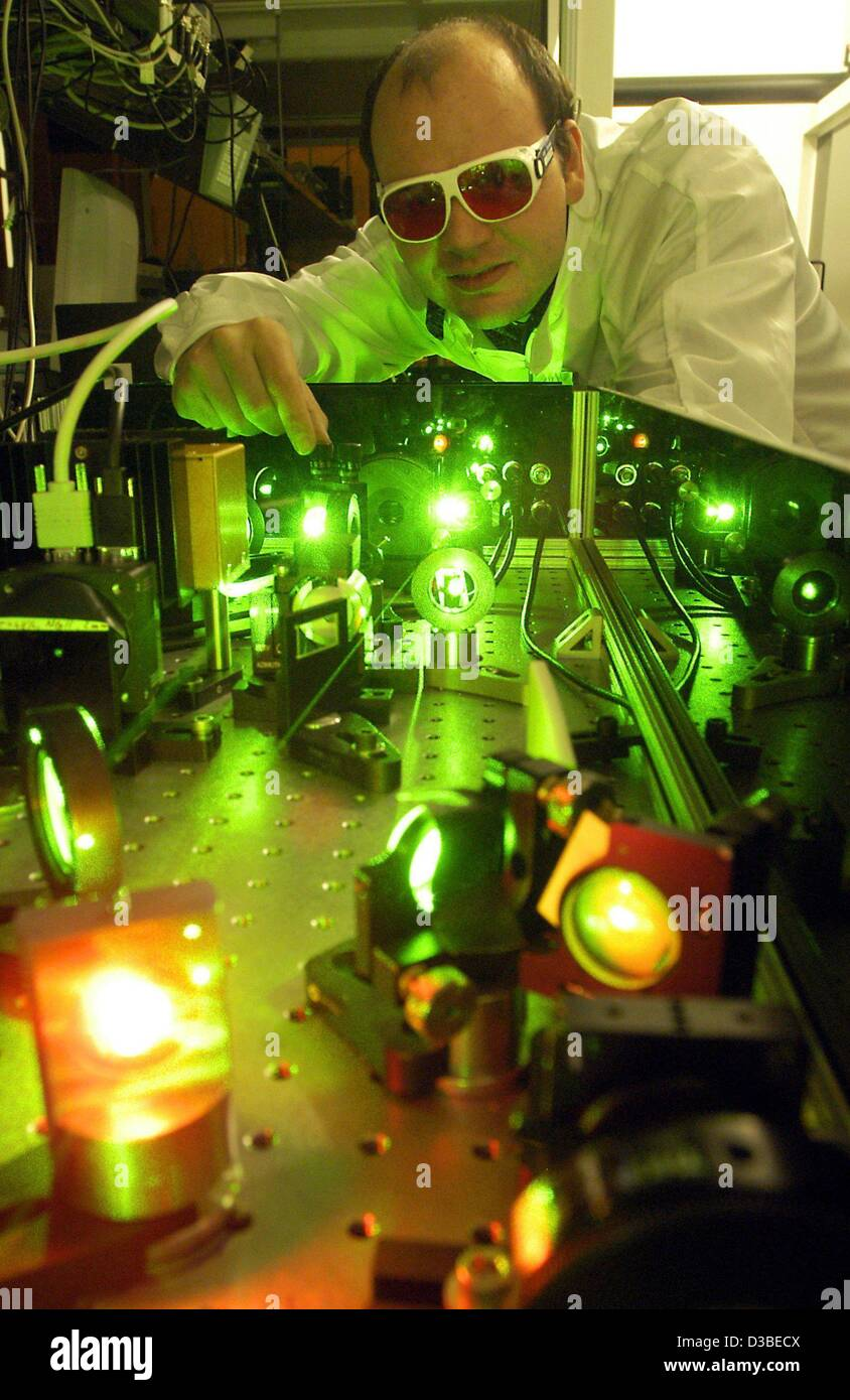(dpa) - A member of the 'Gesellschaft für Schwerionenforschung GSI' (heavy ion research centre) works at a pre-amplifier Stock Photo