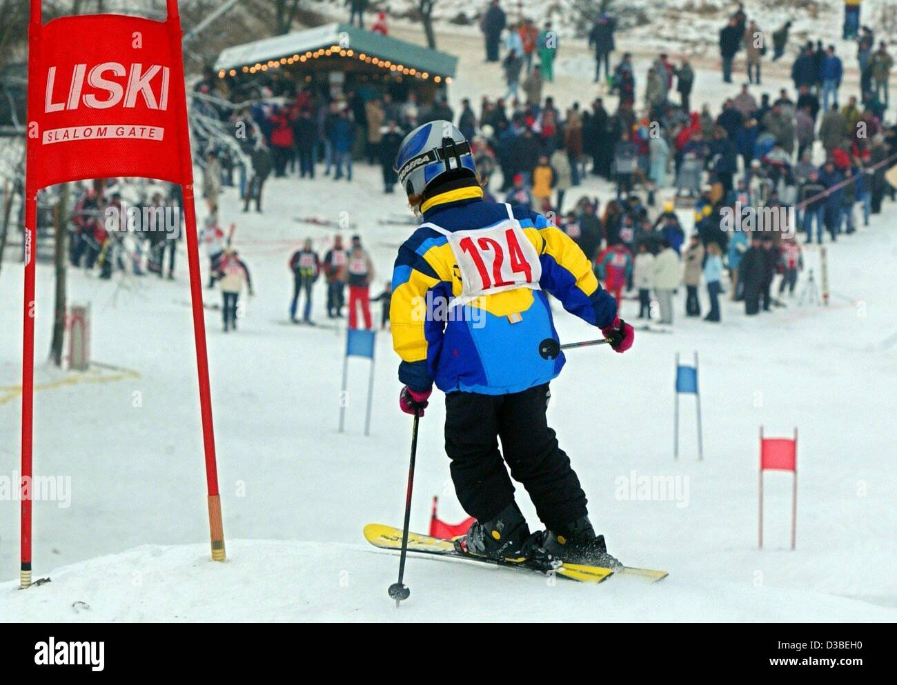 (dpa) - A young participant skis down the well-prepared Diehlow Mountain in Eisenhuettenstadt, northern Germany, Stock Photo