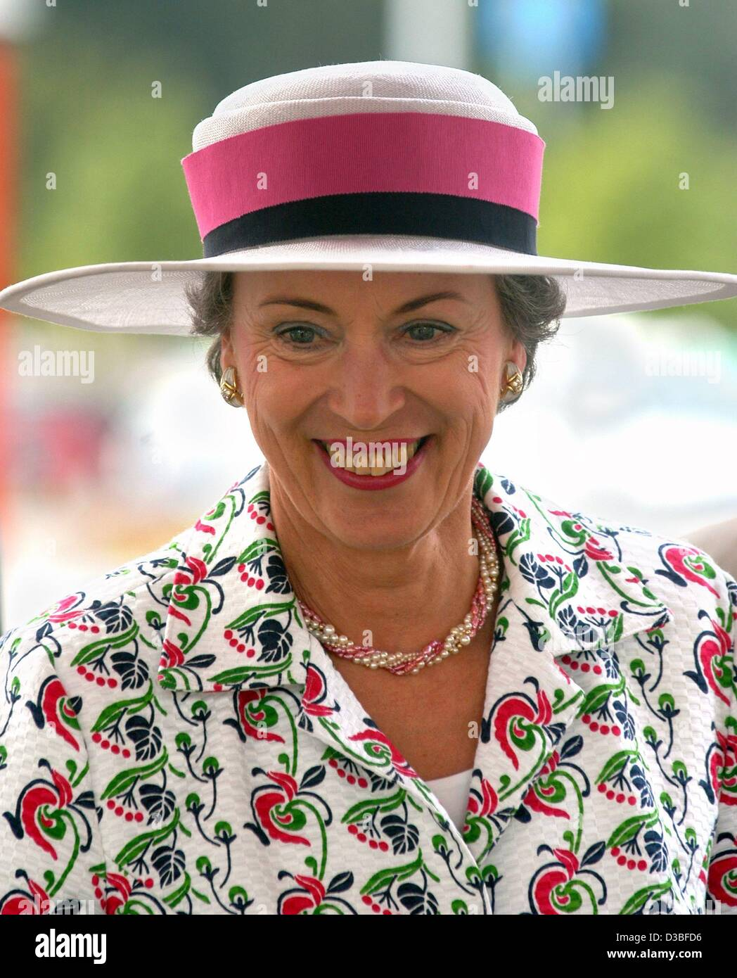 (dpa) - Danish princess Benedikte wears a hat and a flowery dress and smiles during her visits to the Legoland park - Stock Image