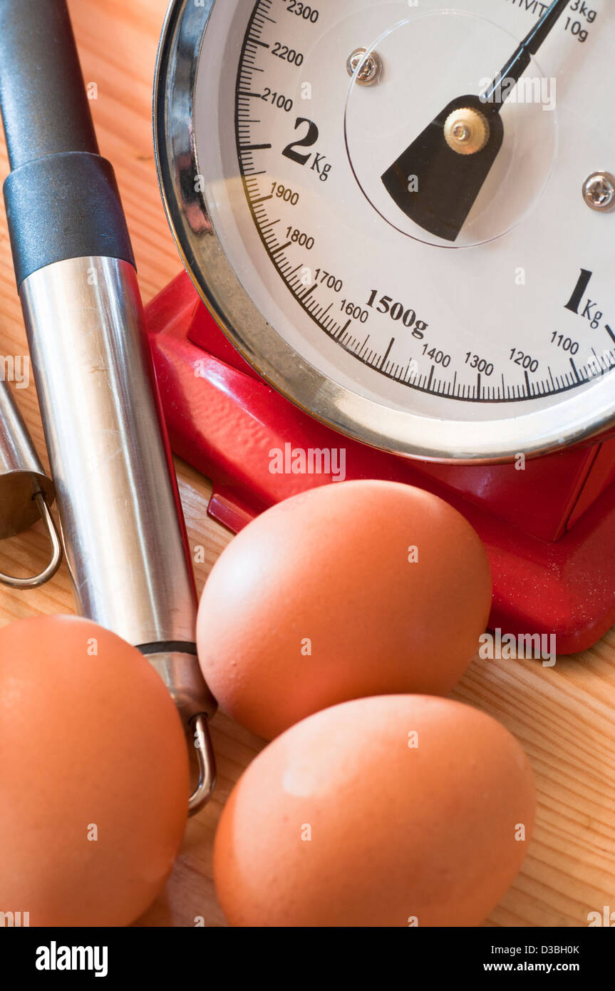 Eggs and kitchen scales for baking Stock Photo