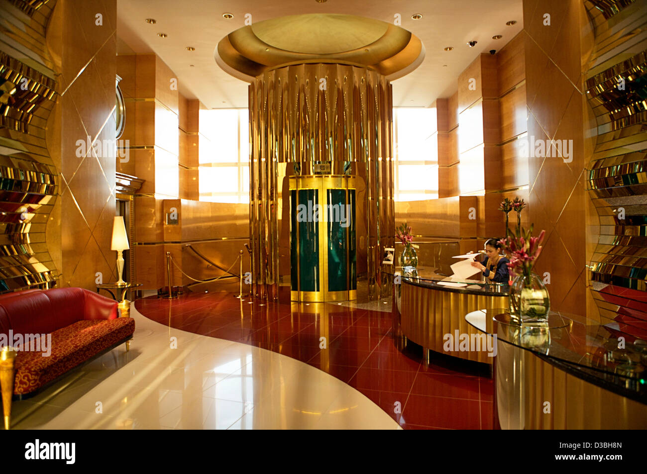 The gold interior reception and elevator area of the seven ... Burj Al Arab Elevator Inside