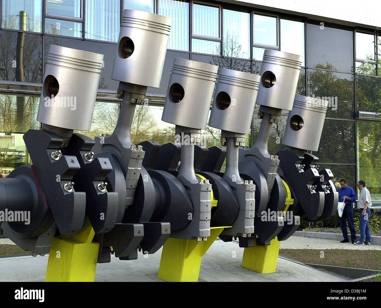 (dpa) - Oversize pistons for a car engine stand like a sculpture in front of a building of the car parts manufacturer Stock Photo