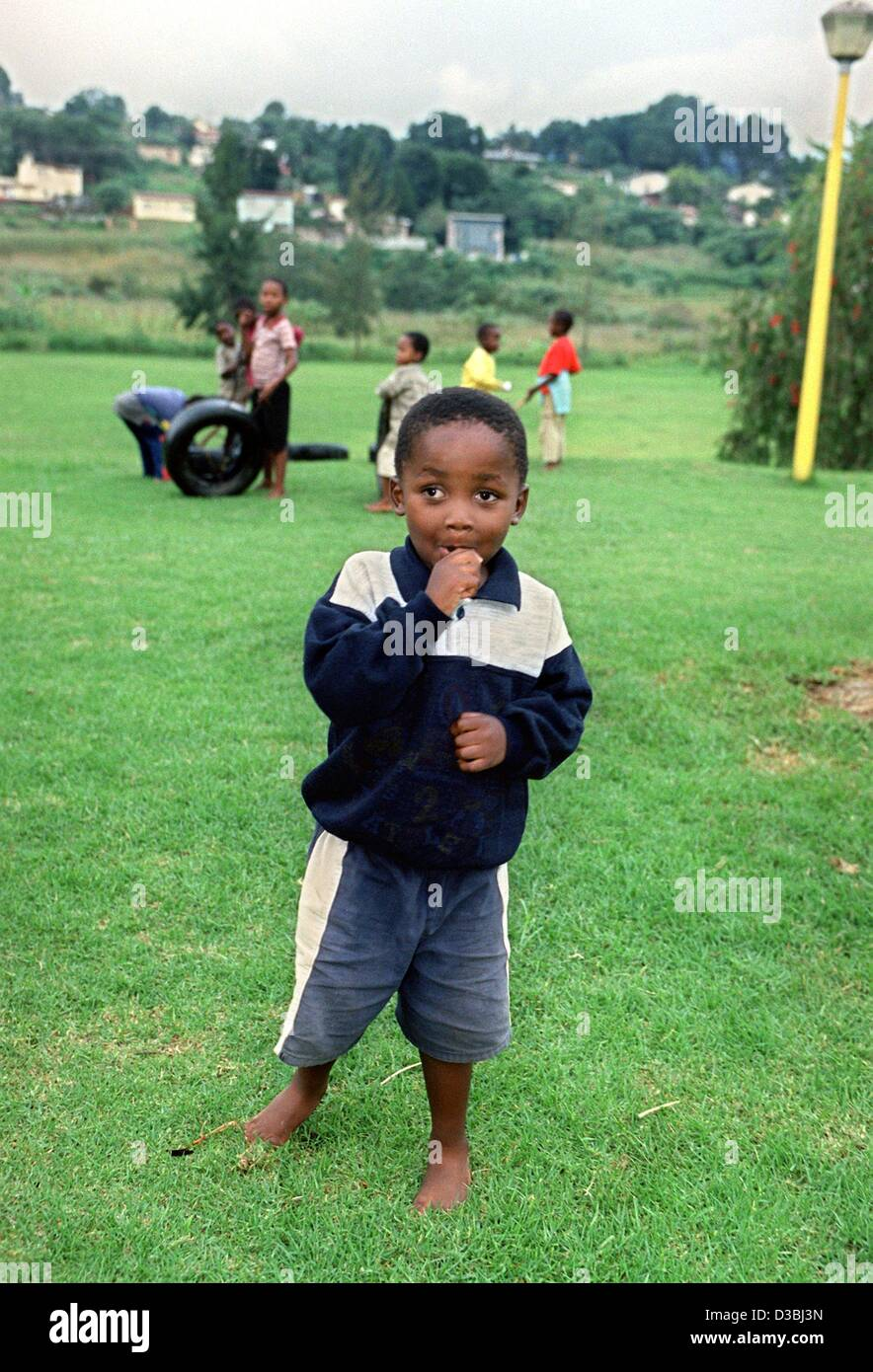 (dpa files) - With his eyes wide open, a boy stands on the lawn of the SOS Children's Village in Mbabane, Swaziland, - Stock Image
