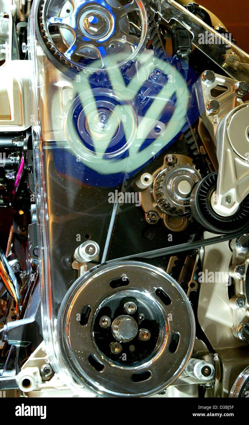 (dpa) - The logo of German Volkswagen (VW) car manufacturers is reflected on the glass cover of a VW New Beetle - Stock Image