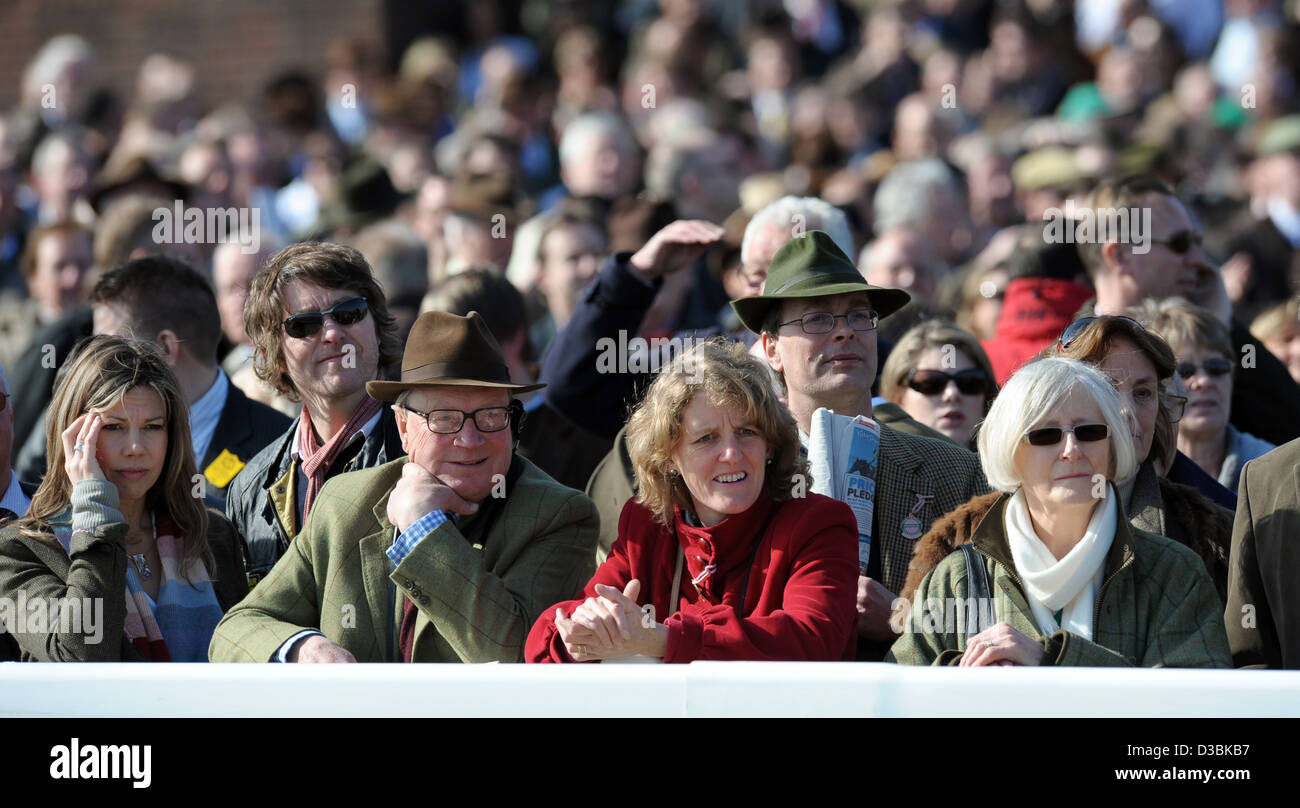 People watch the racing during the Cheltenham Festival, an annual horse racing fixture in southwest England Stock Photo