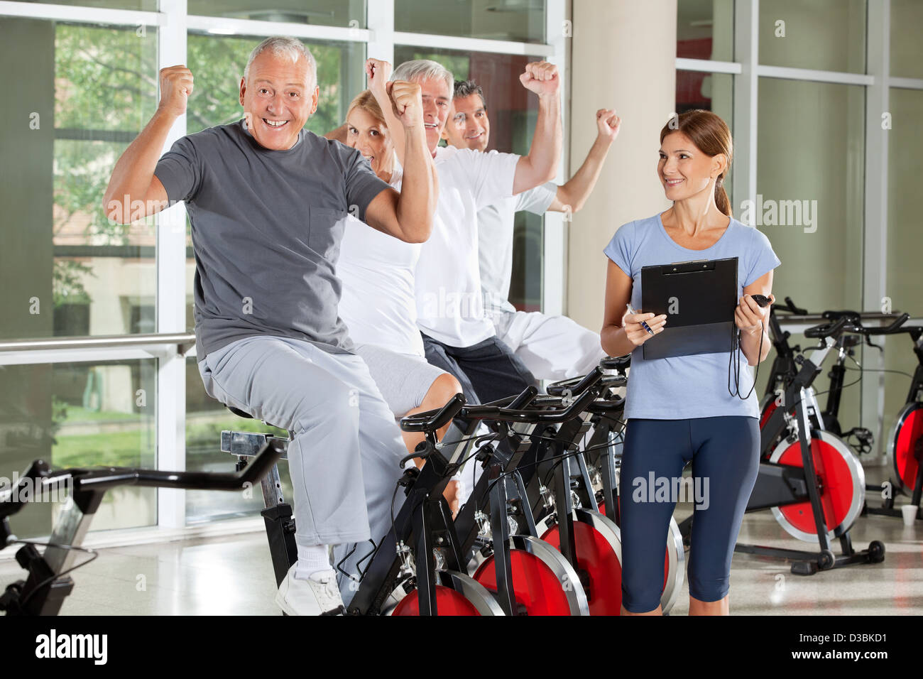 Elderly woman home trainer stock photos elderly woman home