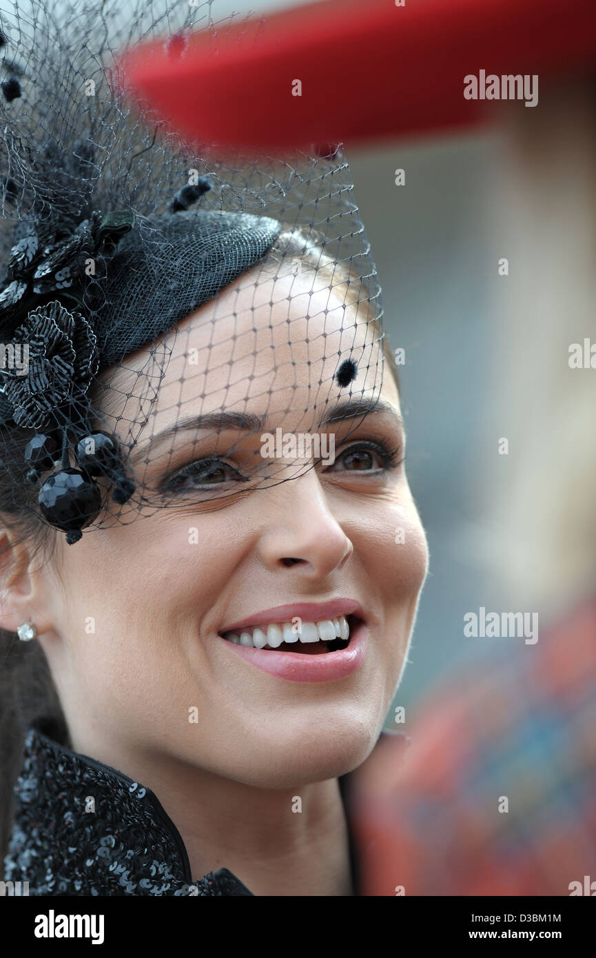 A woman arrives for Ladies Day at the Cheltenham Festival an annual horse racing event. Stock Photo