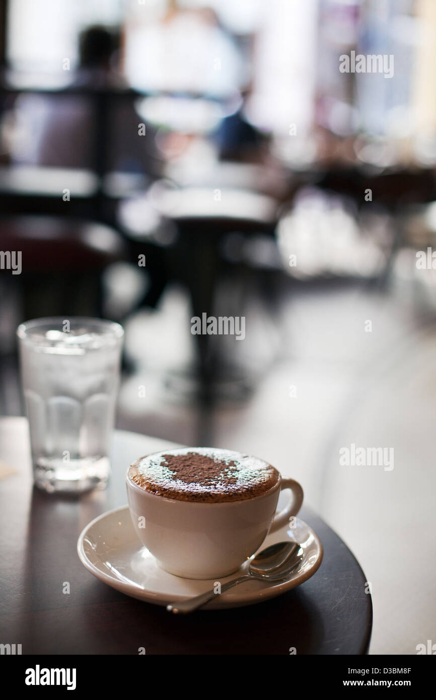 Cappuccino on coffee shop table. Perth, Western Australia, Australia - Stock Image