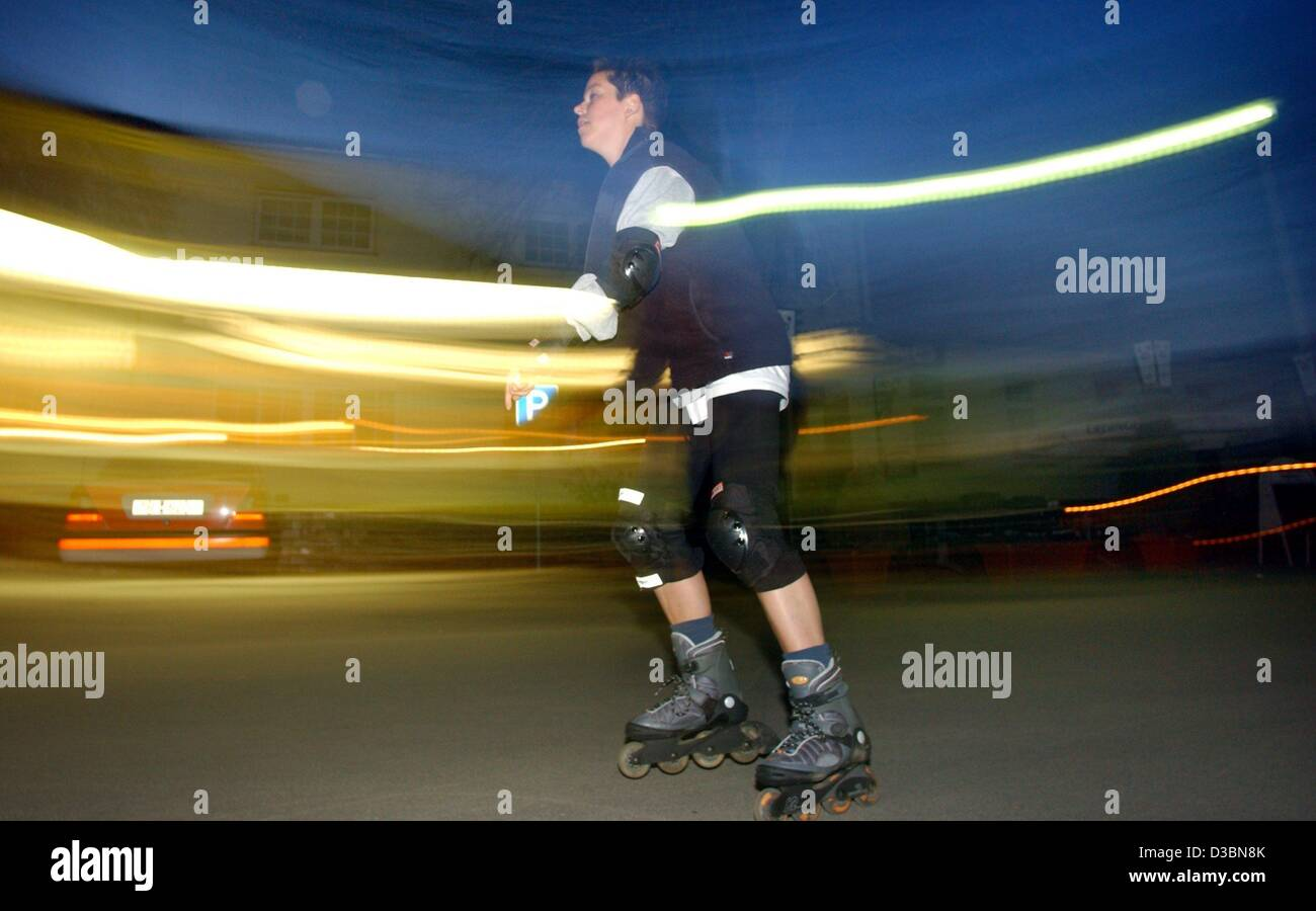 (dpa) - Lines of lights are seen as a skater races in the evening light along the Flaeming Skate, one of the largest - Stock Image