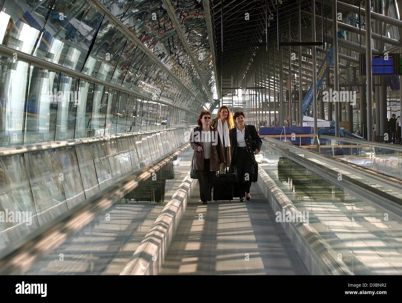 (dpa) - A group of passangers walk on their way to the check-in area of the new central terminal at the Leipzig Stock Photo