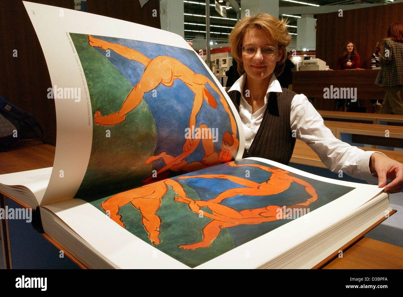 (dpa) - Ruth Schoellhammer leafs through titled 'Revolution and painting', published by Art-Media-Edizione, - Stock Image