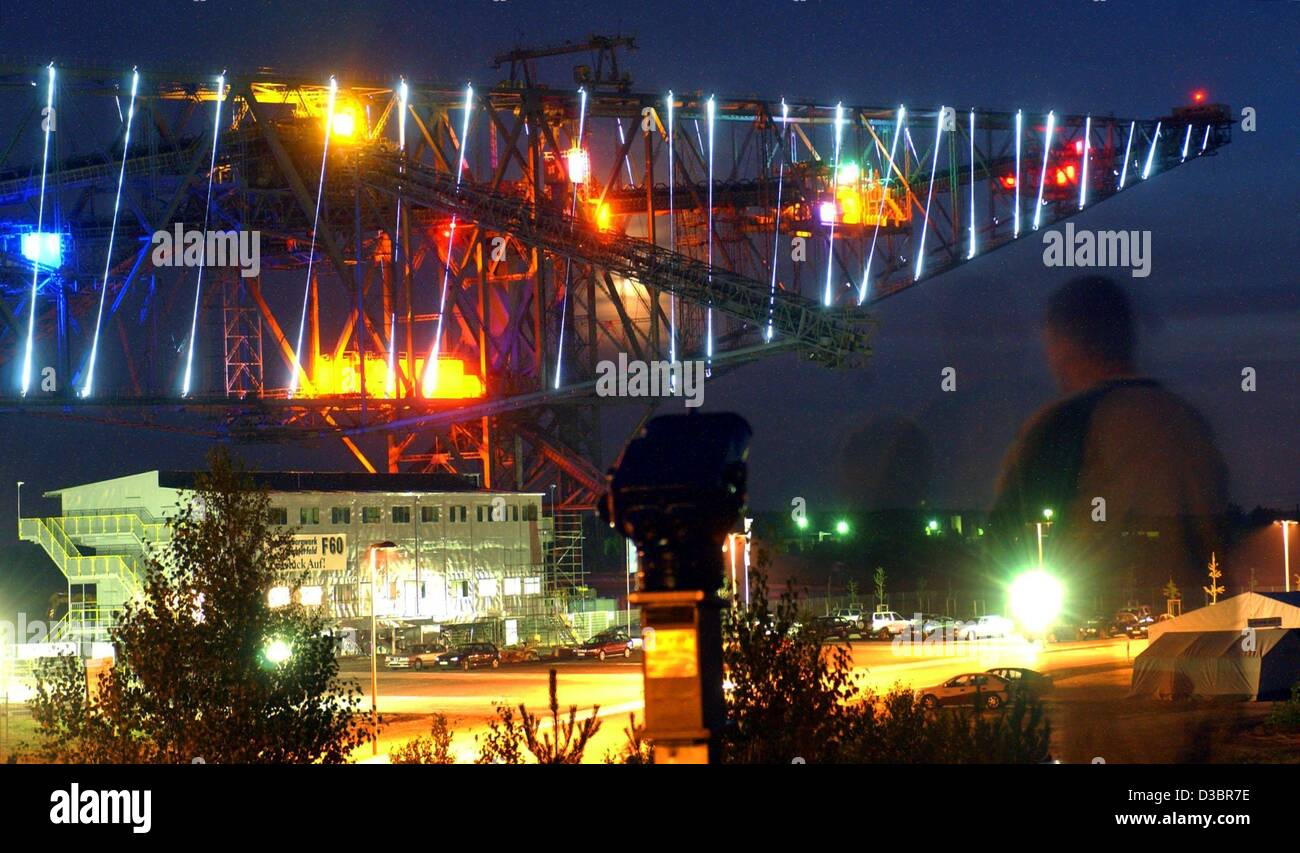 (dpa) - The so-called 'lying Eiffel tower', a F60 conveyor belt bridge for colliery waste, is illuminated by a light Stock Photo