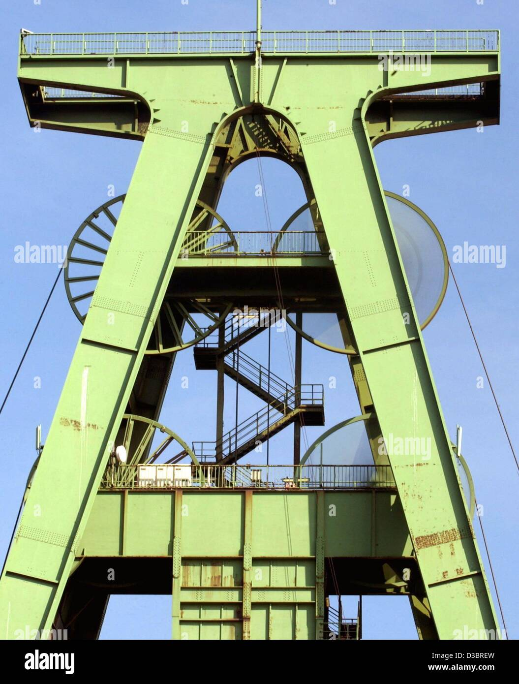 (dpa) - Two of the four wheels on the winding tower continue to spin around while the other pair stand still at Stock Photo