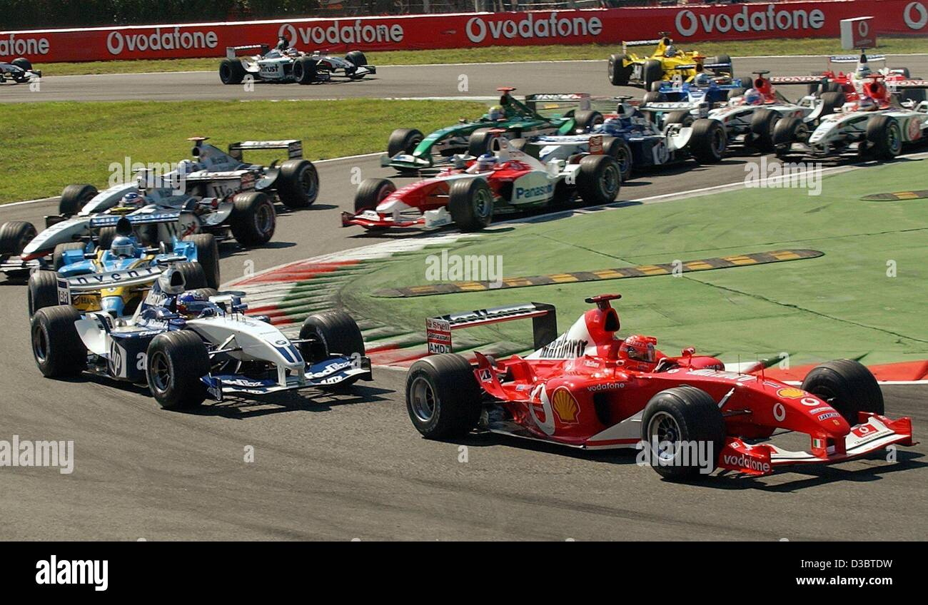 (dpa) - German formula one pilot Michael Schumacher of Ferrari (R) leads the pack ahead of Colombian Juan Pablo - Stock Image