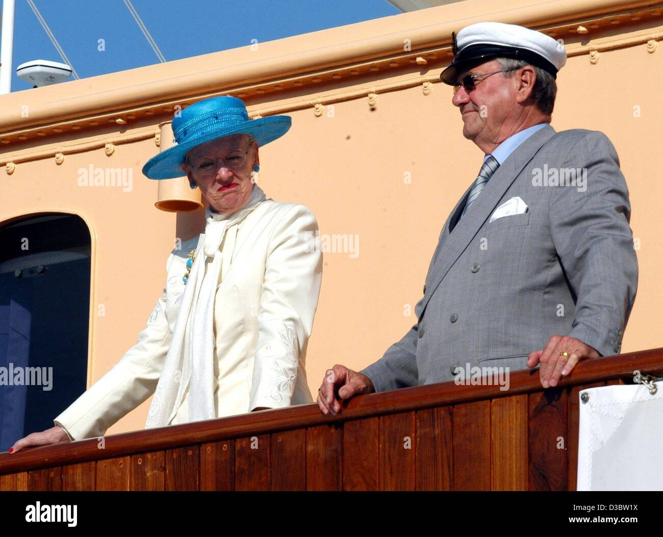 (dpa) - Queen Margrethe II of Denmark and her husband Prince Henrik stand on the deck of the royal yacht Dannebrog - Stock Image