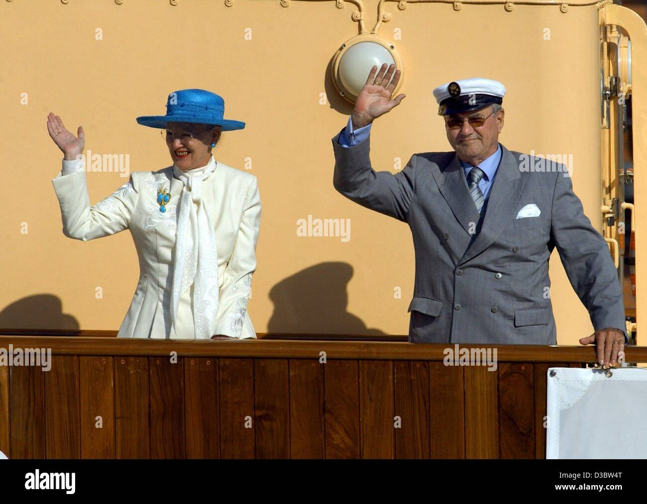 (dpa) - Queen Margrethe II of Denmark and her husband Prince Henrik wave from the deck of the royal yacht Dannebrog - Stock Image