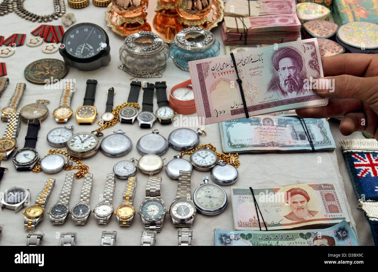 (dpa) - Watches, medals and old notes bearing the face of the assassinated Afghan opposition leader Ahmed Shah Massud - Stock Image