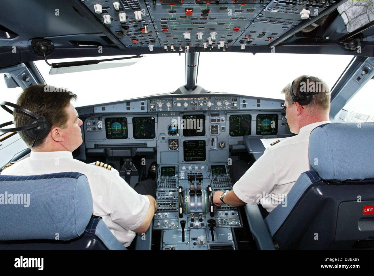 (dpa) - Two pilots of the German airline LTU sit in the cockpit of an Airbus A 321-200 in Hamburg, Germany, 11 July Stock Photo