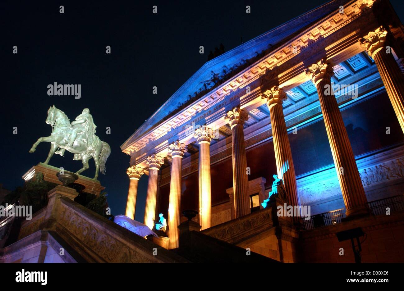 (dpa) - A low angle view towards the illuminated statue of Fredrick William IV and the entrance facade of the Old - Stock Image