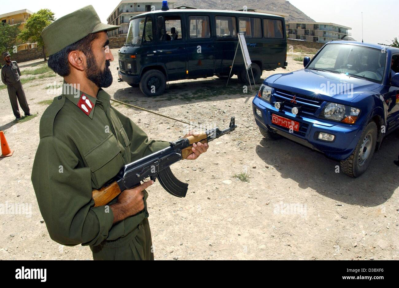 (dpa) - An Afghan police recruit practises how to stop a vehicle and conduct a police check on the premises of the - Stock Image