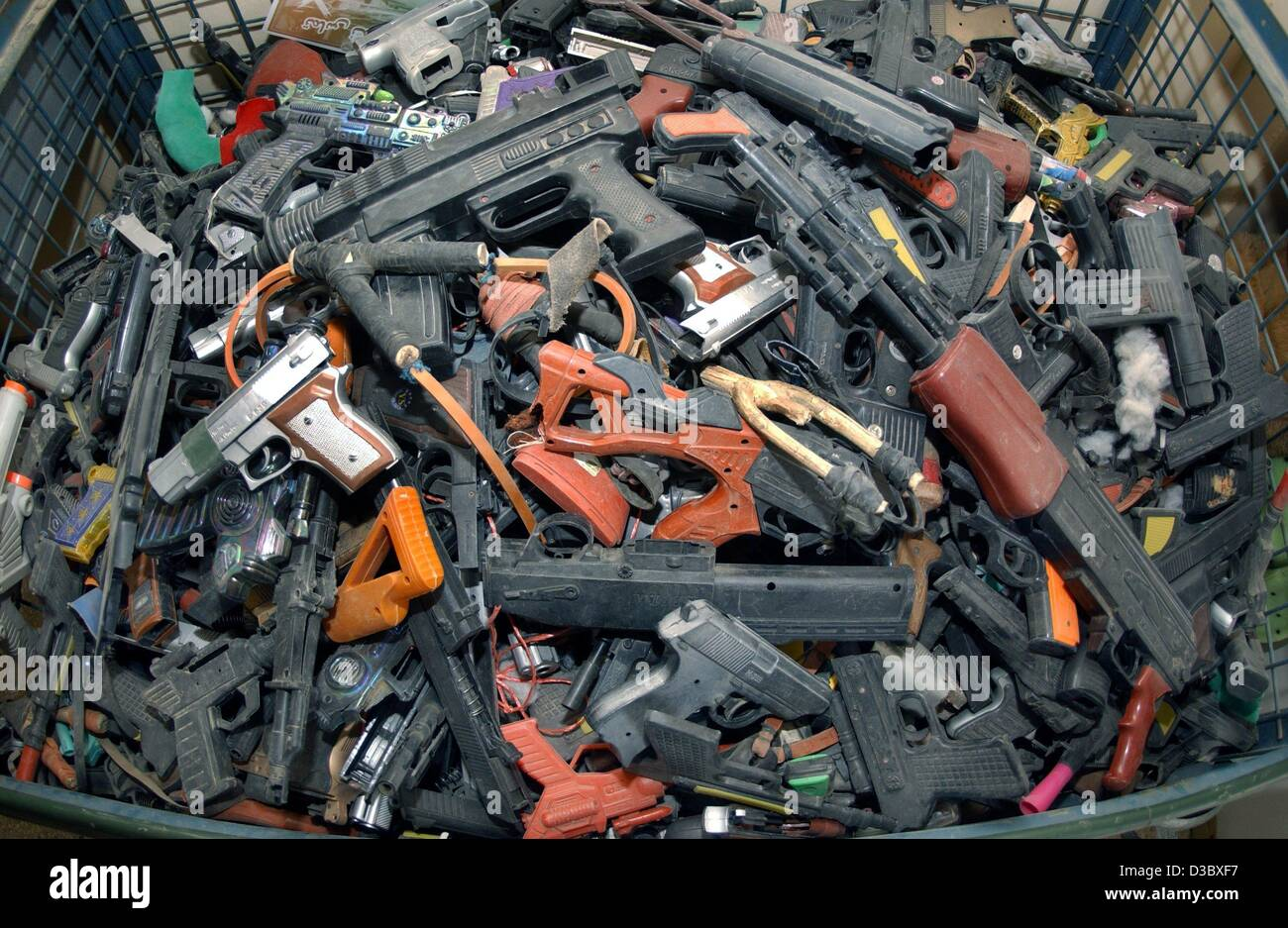 (dpa) - A view of a mountain of confiscated toy guns in a container on the premises of the German military camp Stock Photo