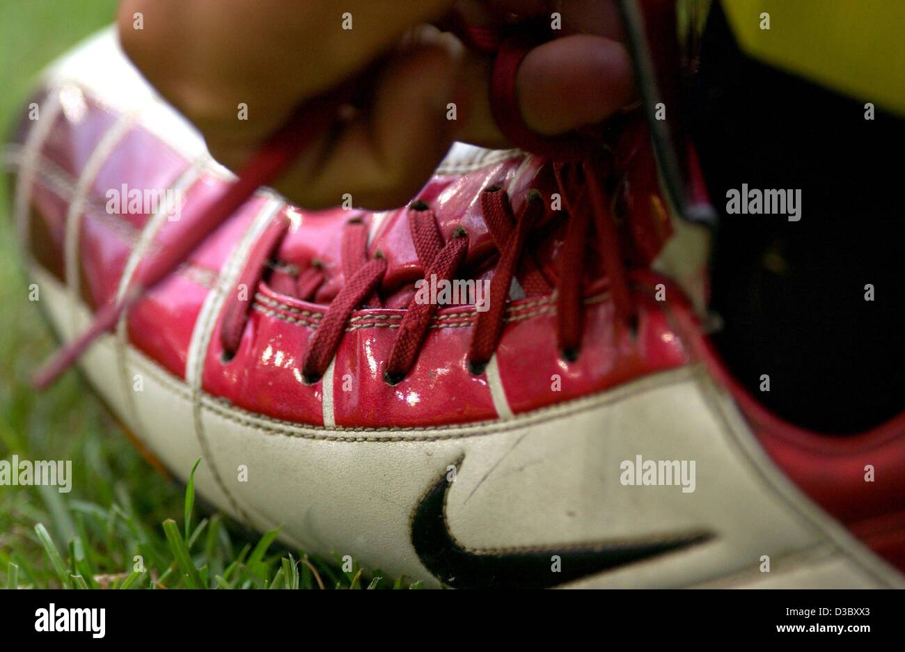 (dpa) - A soccer player of the team Borussia Dortmund ties his Nike trainers during a Bundesliga soccer game in - Stock Image