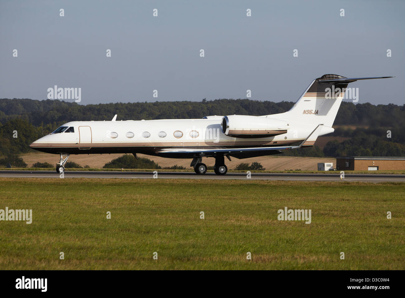 Gulfstream G-IV taking off from runway - Stock Image