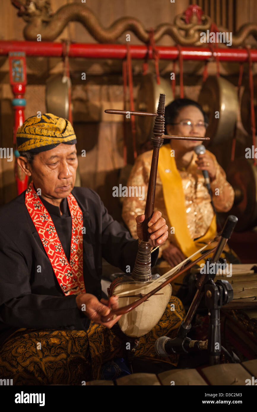 The original Javanese, Indonesian classic musical instrument; Gamelan played by the musician complete with their - Stock Image