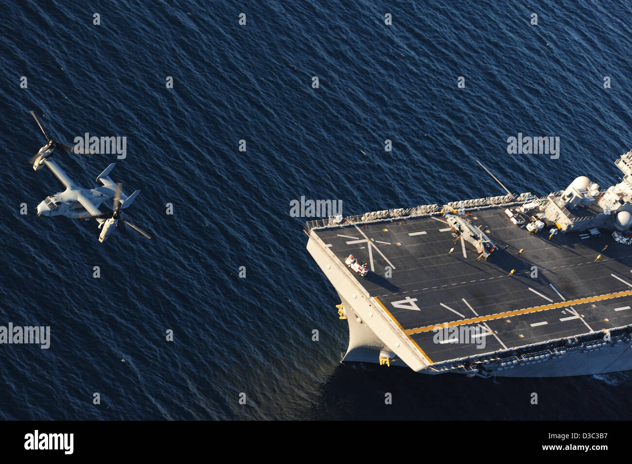 US Navy MV-22 Osprey take off from the multipurpose amphibious assault ship USS Boxer February 13, 2013 underway - Stock Image