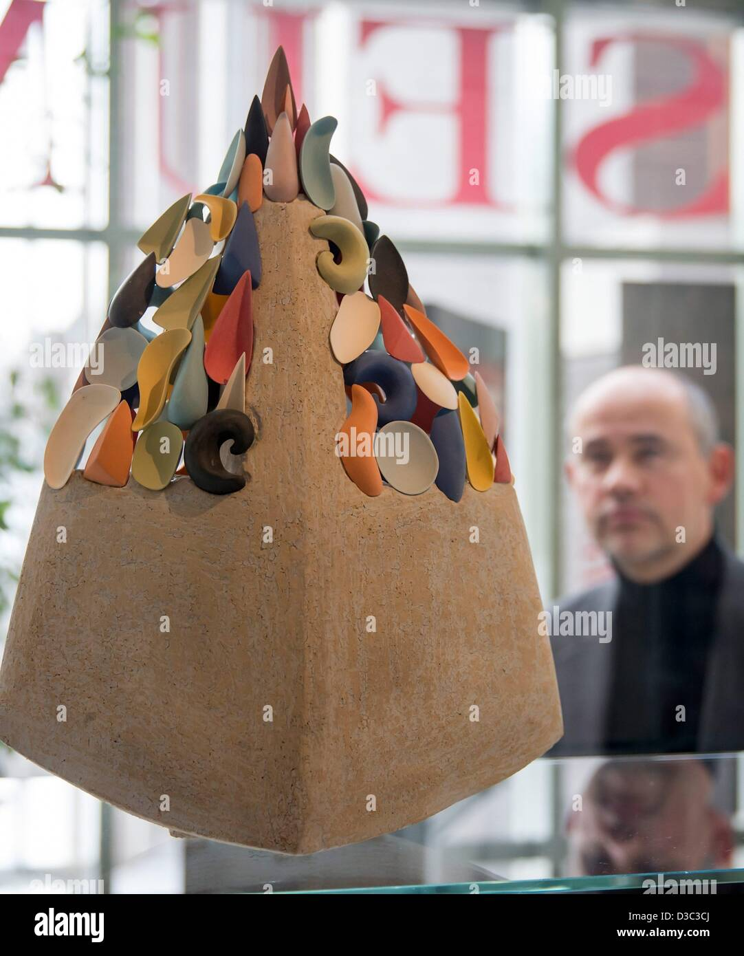 A man looks at the work 'One Summer Day' by Velimir Vukicevic (Serbia) at the exhibition 'Ceramics speaks - Stock Image