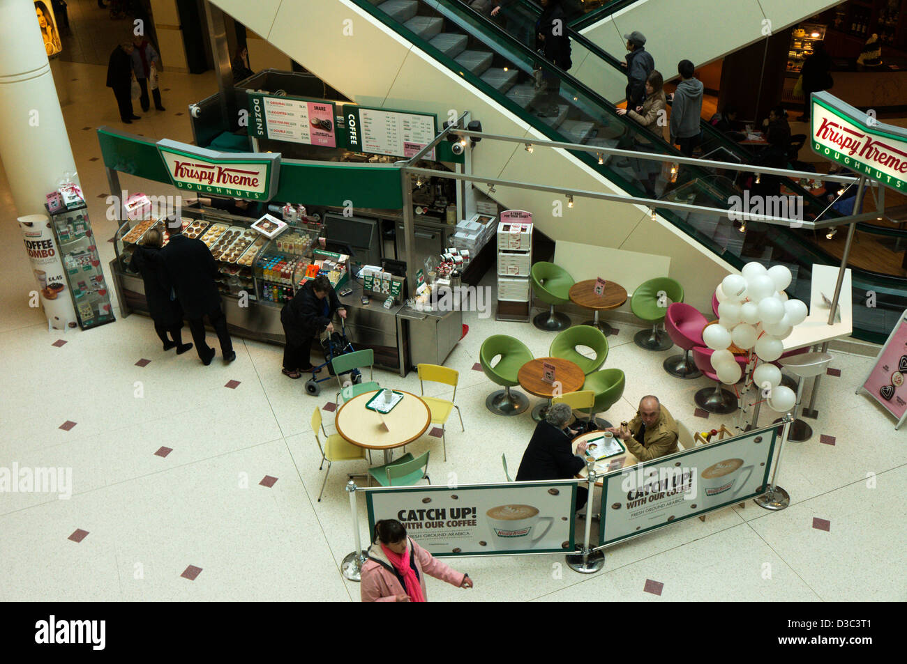 Krispy Kreme Doughnuts kiosk in The Glades shopping centre, Bromley, Kent, now Intu Bromley. - Stock Image