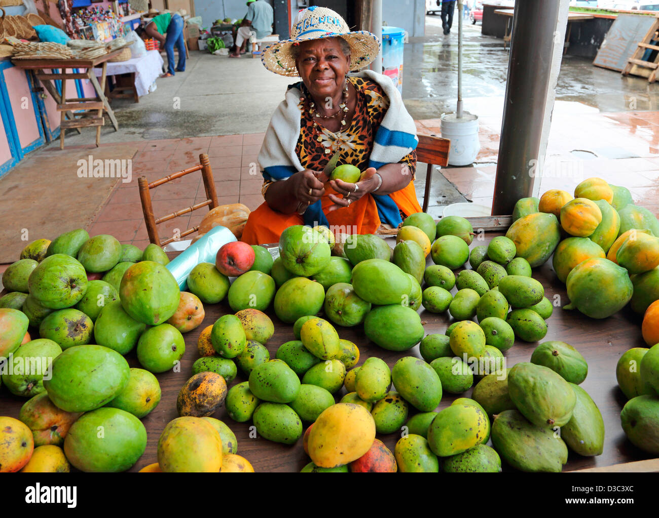 LOCAL WOMAN SELLING MANGOES,CASTRIES MARKET,ST.LUCIA, - Stock Image