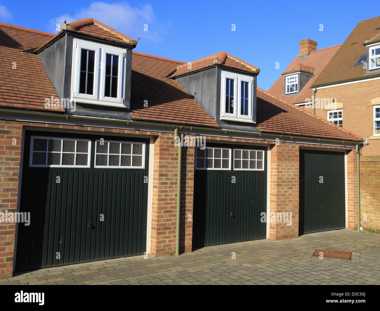 Traditional style garages with wooden doors and Dormer windows & Traditional style garages with wooden doors and Dormer windows Stock ...
