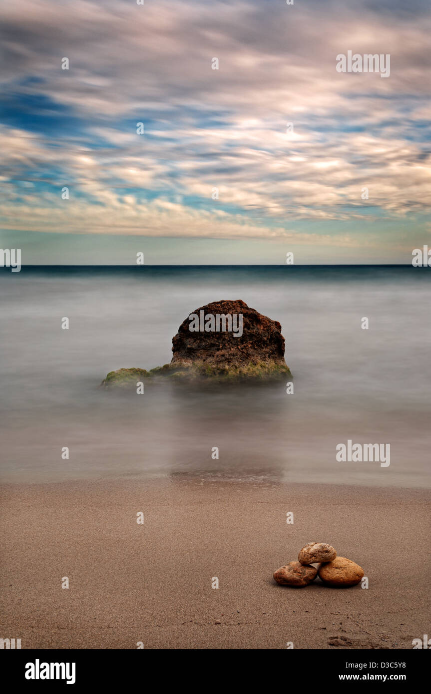 Stones in Sa Caleta beach. Ibiza, Balearic Islands, Spain - Stock Image