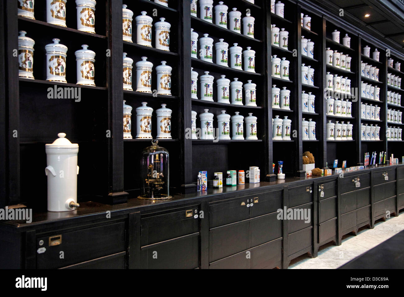 Porcelain jars with medicines and herbs in old pharmacy cabinet of drugstore in the Calle Obispo / Bishop Street, - Stock Image