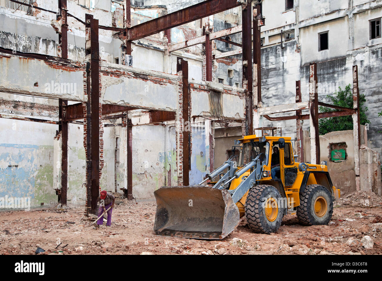 Workers and bulldozer renovating old house in Havana, Cuba, Caribbean - Stock Image