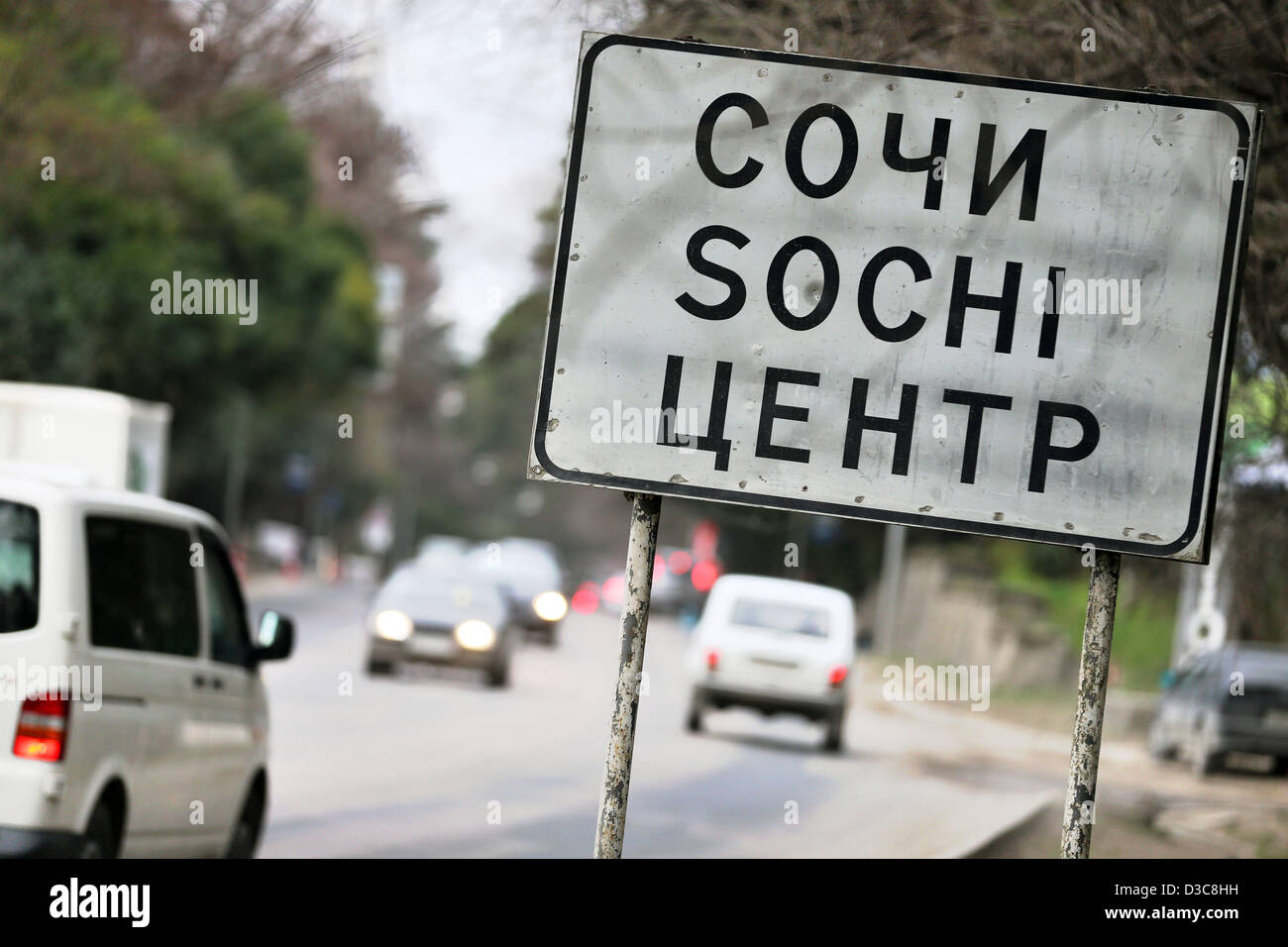 Cars go past the place name sign of Sochi, Russia, 05 February 2013. The 2014 Olympic Games are held in Sochi. Photo: - Stock Image