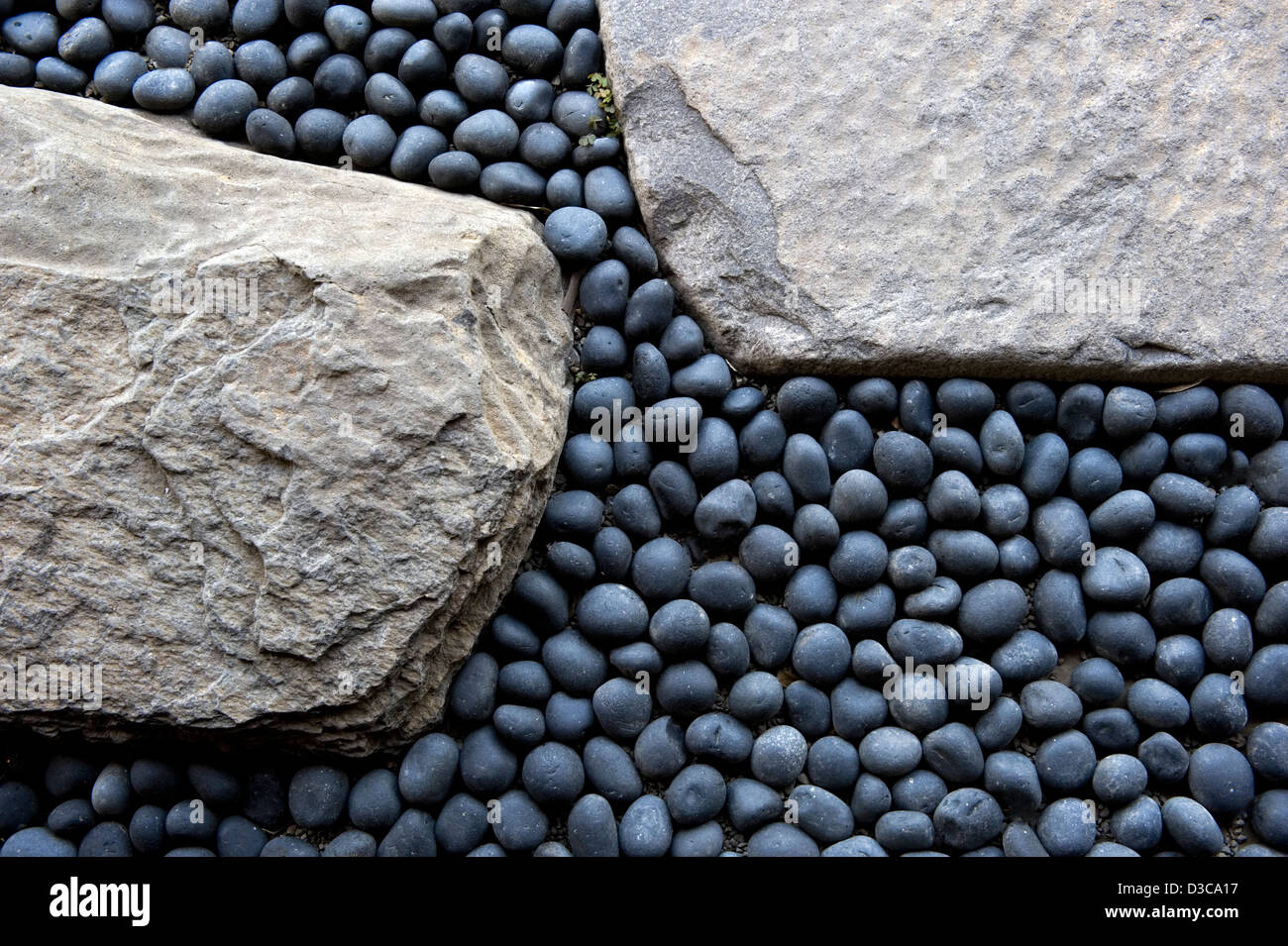 Small, Round, Perfectly Shaped, Blue Gray River Rock Contrasts With Large
