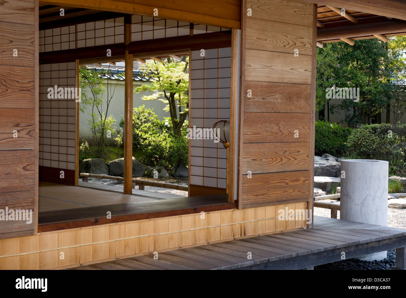 Traditional sliding shoji screens and veranda open to garden and ...
